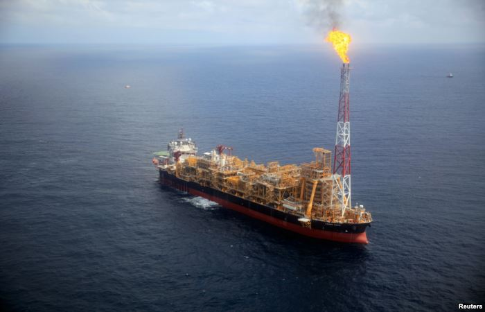 FILE - Kaombo Norte floating oil platform is seen from a helicopter off the c