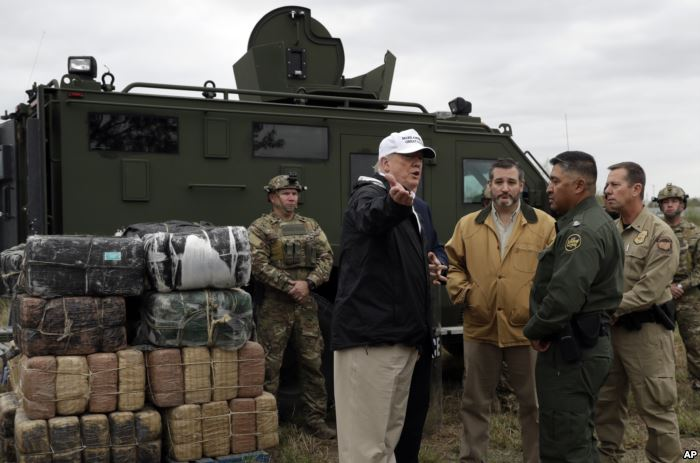 FILE - President Donald Trump tours the U.S. border with Mexico at the Rio Gr