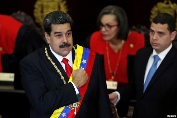 FILE - Venezuela's President Nicolas Maduro gestures during a ceremony to