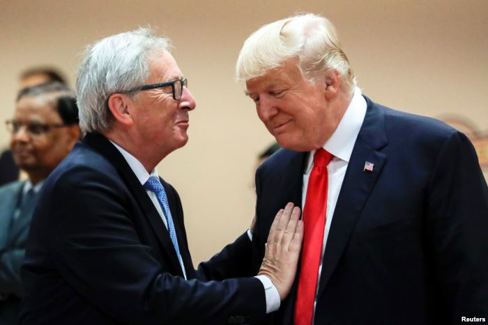 U.S. President Donald Trump, right, talks with European Commission President