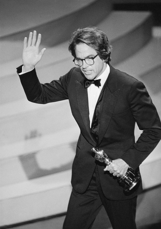 FILE - In this March 29, 1982, file photo, Warren Beatty waves to the audience as he leaves the stage after accepting the Oscar for directing, for the movie