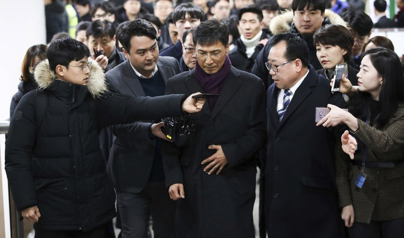 Ahn Hee-jung, center, a former governor of South Chungcheong province, arrives at the Seoul High Court in Seoul, South Korea, Friday, Feb. (Kim Sun-ung/Newsis via AP)