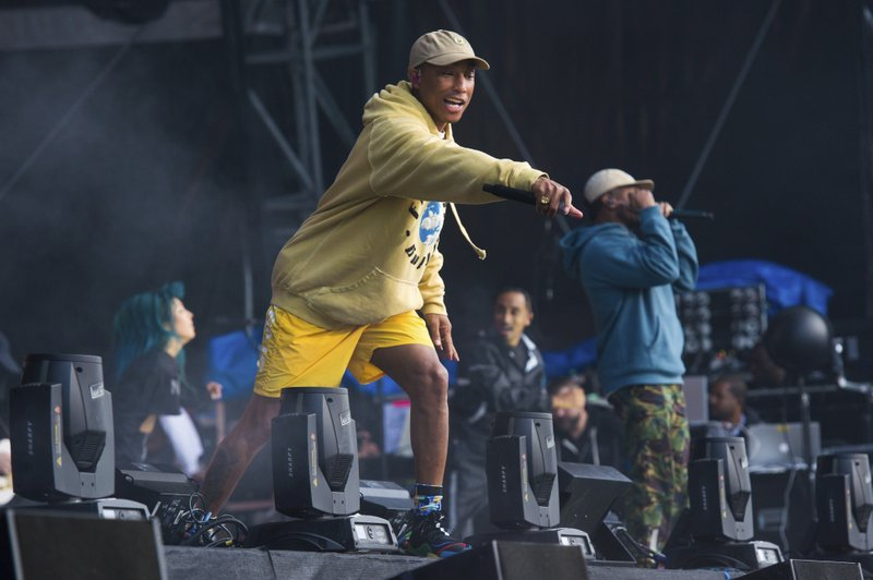 FILE - In this June 3, 2018 file photo, Pharrell Williams of N.E.R.D. performs at The Governors Ball Music Festival at Randall's Island Park in New York. (Photo by Scott Roth/Invision/AP, File)