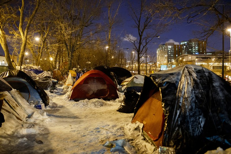 People sleep in tents near a wooded area adjacent to the Dan Ryan Expressway Tuesday Jan. 29, 2019, in Chicago. (Armando L. Sanchez/Chicago Tribune via AP)