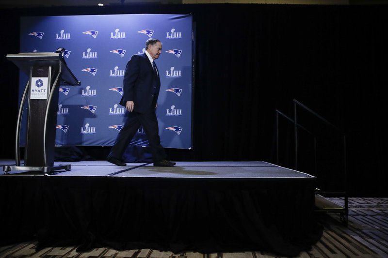 New England Patriots head coach Bill Belichick walks from the podium after speaking with members of the media during a news conference Thursday, Jan. (AP Photo/Matt Rourke)