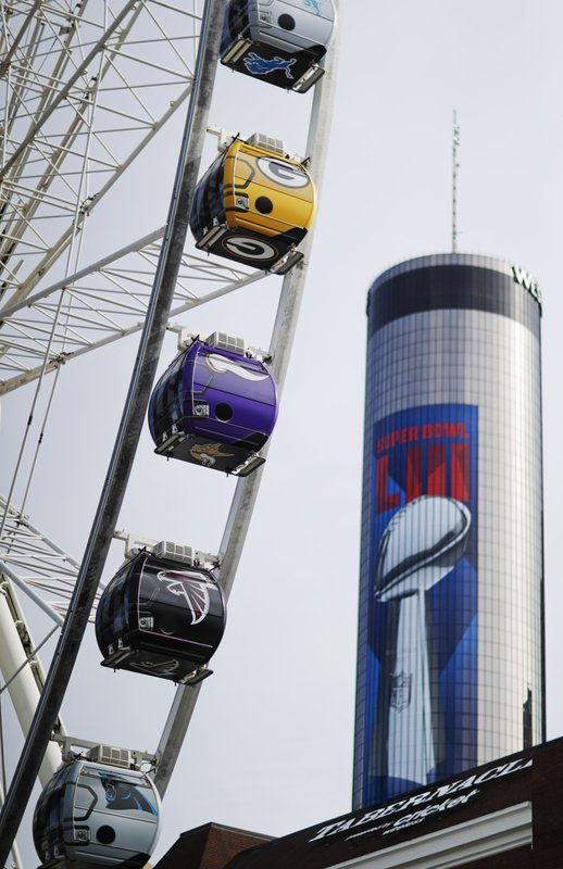 Ferris wheel gondolas are wrapped in the logos of each NFL team ahead of Sunday's Super Bowl 53 football game between the Los Angeles Rams and New England Patriots in Atlanta, Wednesday, Jan. (AP Photo/David Goldman)