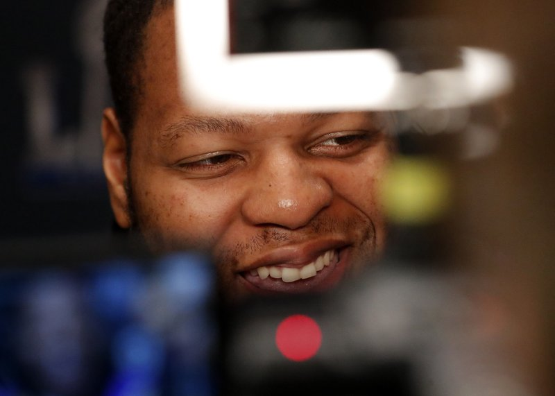 Los Angeles Rams defensive lineman Ndamukong Suh is framed by video cameras as he speaks to reporters during a media availability ahead of the NFL Super Bowl 53 football game against the New England Patriots Wednesday, Jan. (AP Photo/John Bazemore)