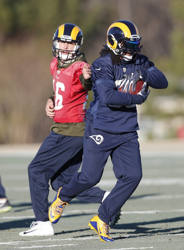 Los Angeles Rams quarterback Jared Goff (16) hands off to running back Todd Gurley (30)during practice for the NFL Super Bowl 53 football game against the New England Patriots, Thursday, Jan. (AP Photo/John Bazemore)