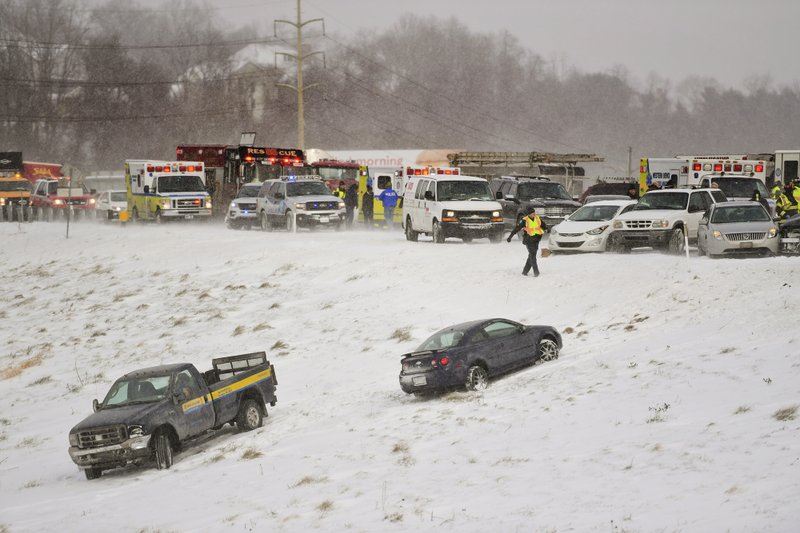 FILE - In this Jan 30, 2019, file photo, emergency responders help victims from their cars after a multi car pile up after a snow squall in Wyomissing, Pa. (Lauren A. Little/Reading Eagle via AP, File)