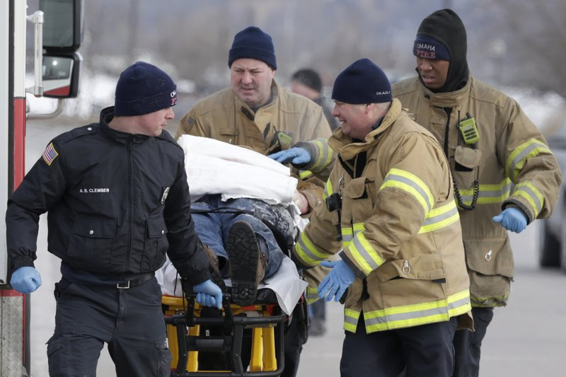 FILE - In this Jan 30, 2019, file photo, first responders evacuate a person found in sub-freezing temperatures on the banks of Carter Lake, in Omaha, Neb. (AP Photo/Nati Harnik, File)