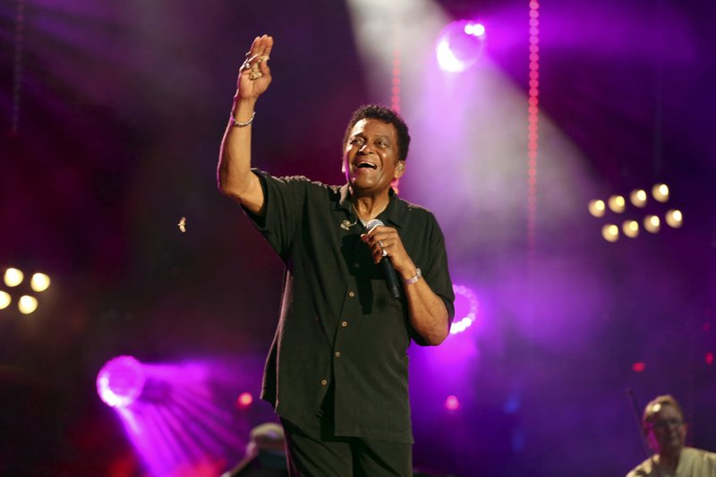 FILE - In this June 8, 2018 file photo, Charley Pride performs at the 2018 CMA Music Festival in Nashville, Tenn. (Photo by Laura Roberts/Invision/AP, File)