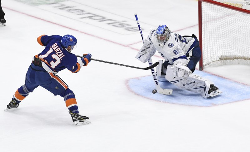 New York Islanders' Mathew Barzal (13) is unable to score on Tampa Bay Lightning goaltender Andrei Vasilevskiy (88) during the shootout in an NHL hockey game Friday, Feb. (AP Photo/Kathleen Malone-Van Dyke)