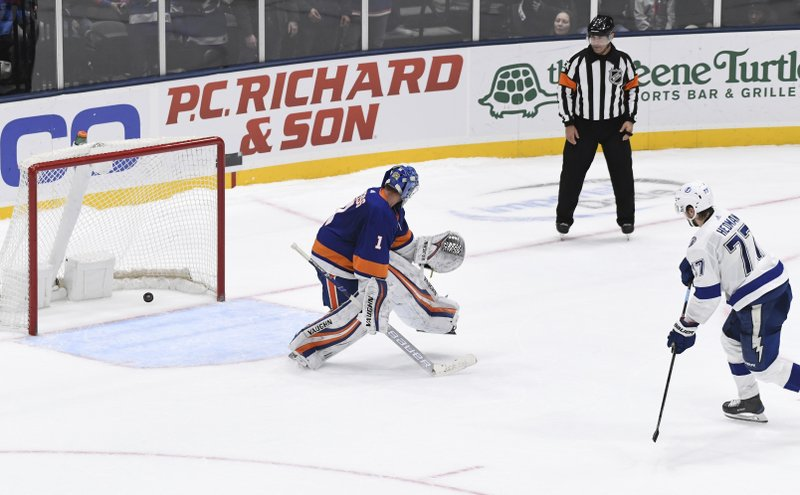 Tampa Bay Lightning's Victor Hedman (77) scores past New York Islanders goaltender Thomas Greiss (1) during the shootout in an NHL hockey game Friday, Feb. (AP Photo/Kathleen Malone-Van Dyke)