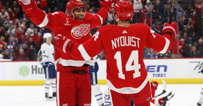 Detroit Red Wings right wing Gustav Nyquist (14) celebrates his goal with  Andreas Athanasiou in the second period of an NHL hockey game against the  Toronto ... 4d3b1daa7