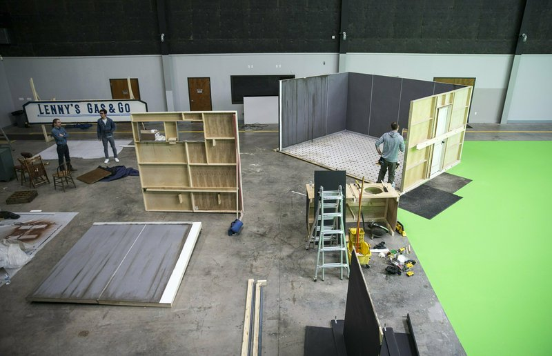 In this Thursday, Jan. 24, 2019 photo, Wesley Falk, right, works on building a set for an upcoming movie at the New Republic Studios in Austin, Texas. (Ricardo Brazziell/Austin American-Statesman via AP)