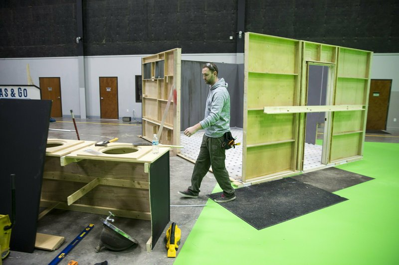In this Thursday, Jan. 24, 2019 photo, Wesley Falk works on building a set for an upcoming movie at the New Republic Studios in Austin, Texas. (Ricardo Brazziell/Austin American-Statesman via AP)