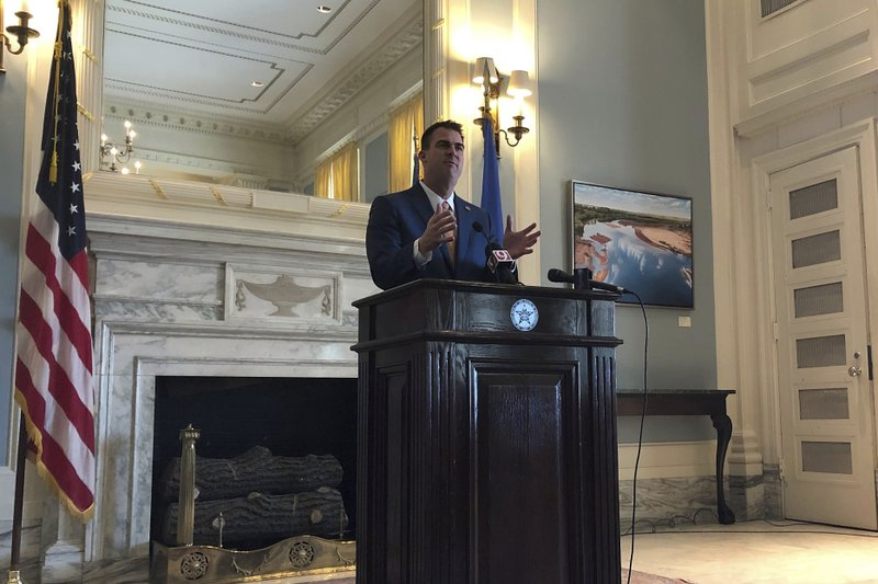 Oklahoma Gov. Kevin Stitt answers reporters' questions Wednesday, Jan. 30, 2019, at forum sponsored by The Associated Press in the state Capitol in Oklahoma City, Okla. (AP Photo/Adam Kealoha Causey)