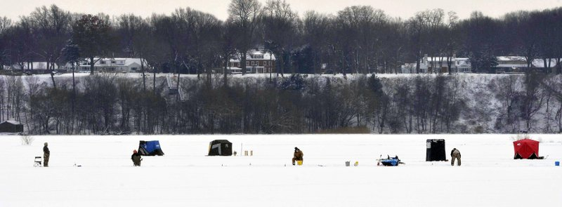 In this Saturday, Jan. 26, 2019 photo, anglers sit on a frozen Presque Isle Bay while ice fishing in Erie, Pa. (Greg Wohlford/Erie Times-News via AP)