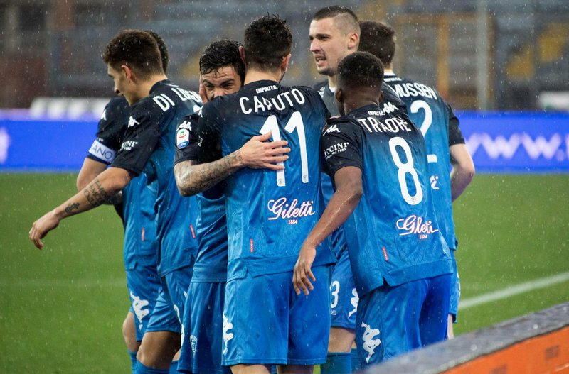 Empoli's Francesco Caputo, number 11, celebrates with teammates after scoring during the Serie A soccer match between Empoli and Chievo Verona at the Carlo Castellani stadium in Empoli, Italy. (Gianni Nucci/ANSA via AP)