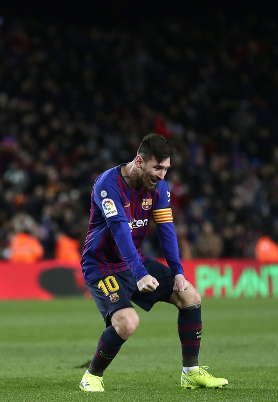 FC Barcelona's Lionel Messi celebrates after scoring during the Spanish La Liga soccer match between FC Barcelona and Valencia at the Camp Nou stadium in Barcelona, Spain, Saturday, Feb. (AP Photo/Manu Fernandez)
