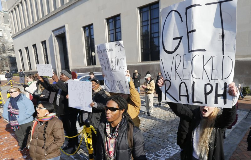 Demonstrators hold signs and chant outside the Governors office at the Capitol in Richmond, Va., Saturday, Feb. (AP Photo/Steve Helber)