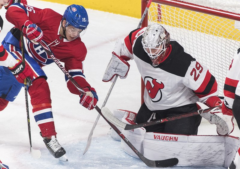 Montreal Canadiens' Jesperi Kotkaniemi (15) moves in on New Jersey Devils goaltender Mackenzie Blackwood during the second period of an NHL hockey game, Saturday, Feb. (Graham Hughes/The Canadian Press via AP)