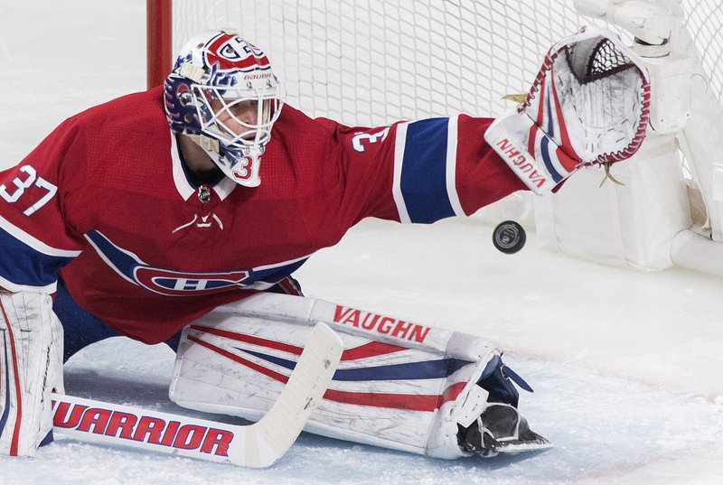Montreal Canadiens goaltender Antti Niemi is scored on by New Jersey Devils' Will Butcher during the first period of an NHL hockey game in Montreal, Saturday, Feb. (Graham Hughes/The Canadian Press via AP)