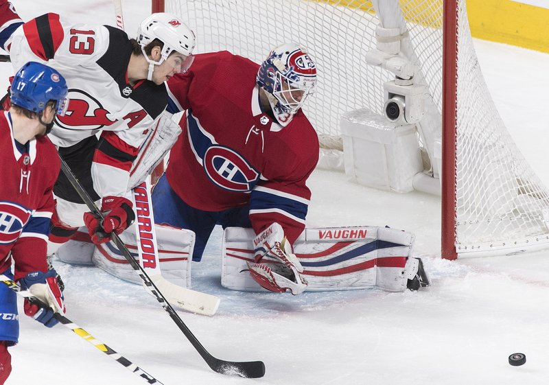 New Jersey Devils' Nico Hischier moves in on Montreal Canadiens goaltender Antti Niemi during the first period of an NHL hockey game in Montreal, Saturday, Feb. (Graham Hughes/The Canadian Press via AP)