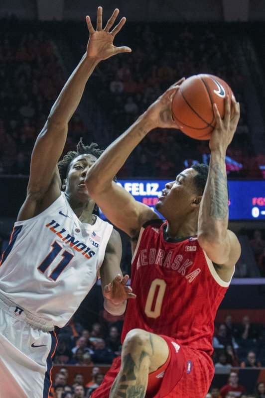Nebraska's guard James Palmer Jr. (0) is guarded by Illinois guard Ayo Dosunmu (11) during the first half of an NCAA college basketball game in Champaign, Ill. (AP Photo/Robin Scholz)