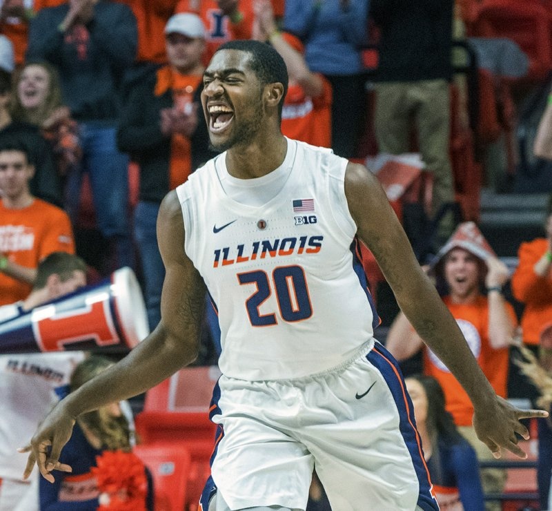 Illinois guard Da'Monte Williams (20) reacts to scoring a 3-pointer against Nebraska during the first half of an NCAA college basketball game in Champaign, Ill. (AP Photo/Robin Scholz)