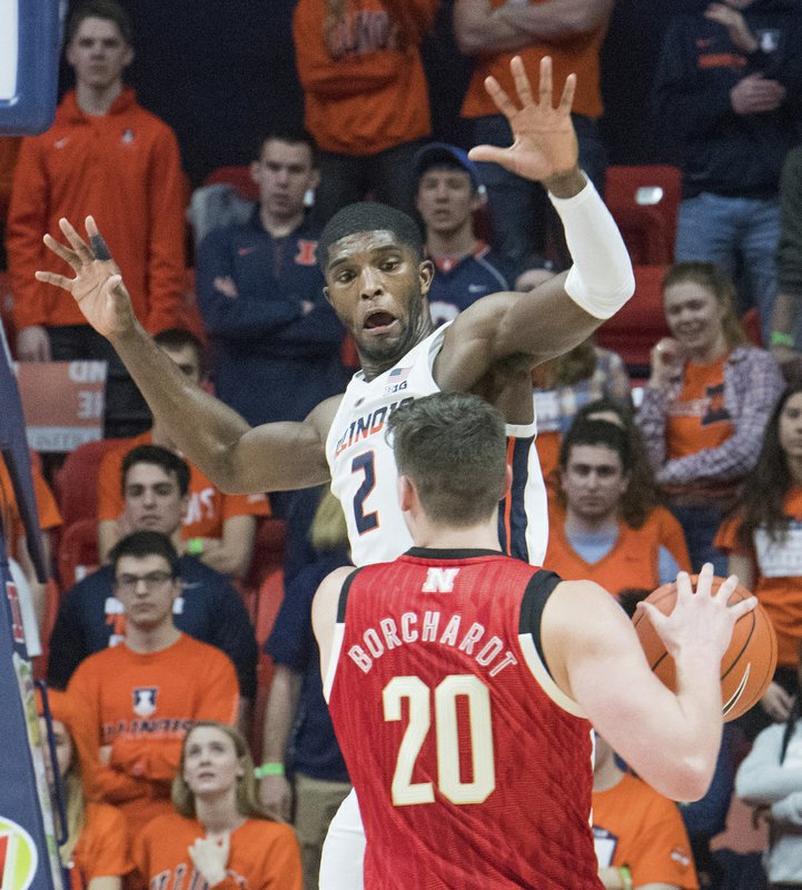 Illinois forward Kipper Nichols (2) guards Nebraska forward Tanner Borchardt (20) during the second half of an NCAA college basketball game in Champaign, Ill. (AP Photo/Robin Scholz)