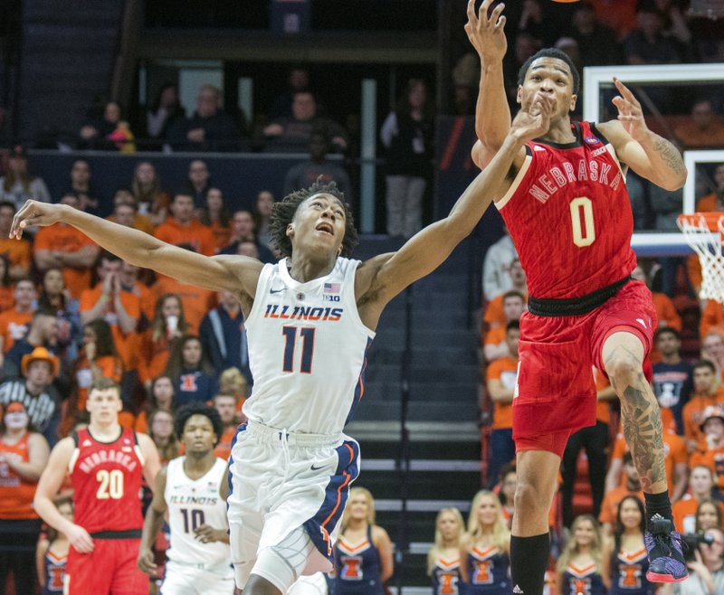 Illinois guard Ayo Dosunmu (11) and Nebraska guard James Palmer Jr. (0) go after the ball during the second half of an NCAA college basketball game in Champaign, Ill. (AP Photo/Robin Scholz)