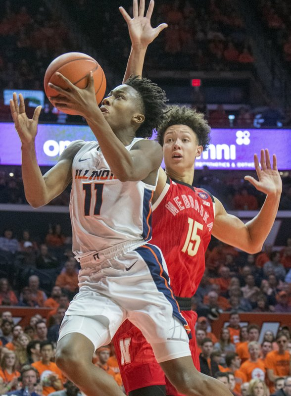 Illinois guard Ayo Dosunmu (11) is pressured by Nebraska forward Isaiah Roby (15) during the second half of an NCAA college basketball game in Champaign, Ill. (AP Photo/Robin Scholz)