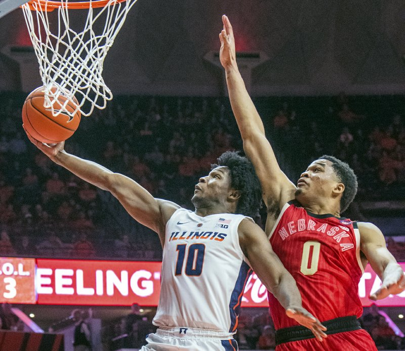 Illinois guard Andres Feliz (10) and Nebraska guard James Palmer Jr. (0) during the second half of an NCAA college basketball game in Champaign, Ill. (AP Photo/Robin Scholz)