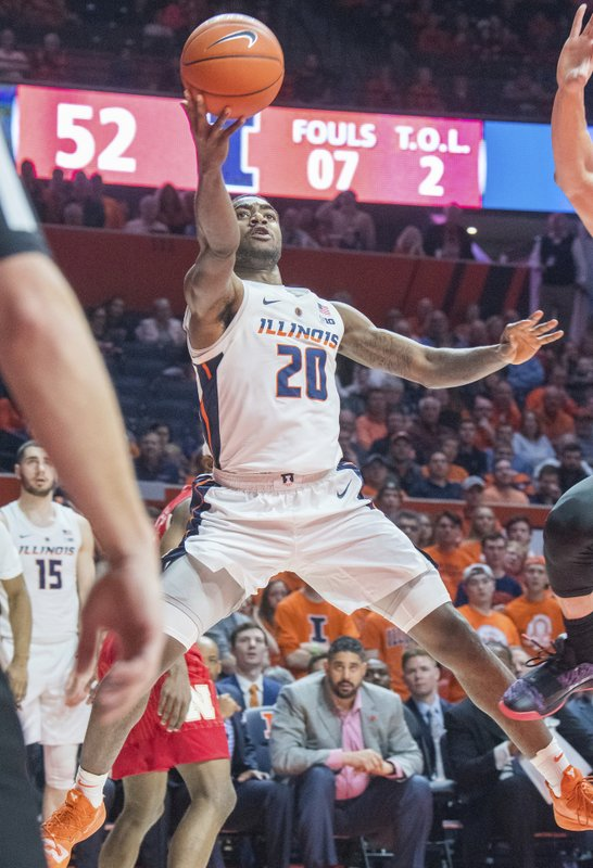 Illinois guard Da'Monte Williams (20) shoots during the second half of an NCAA college basketball game against Nebraska in Champaign, Ill. (AP Photo/Robin Scholz)