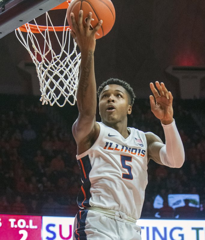 Illinois guard Tevian Jones (5) tips in a pass backward during the second half of an NCAA college basketball game against Nebraska in Champaign, Ill. (AP Photo/Robin Scholz)