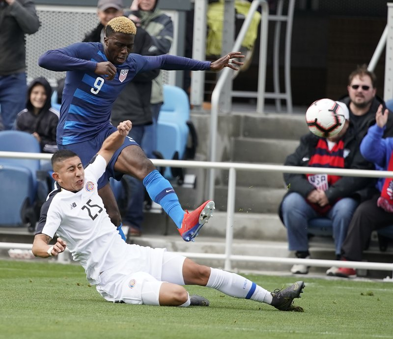 United States forward Gyasi Zardes (9) battles for the ball against Costa Rica midfielder Marvin Loria (25) during the first half of an international friendly soccer match on Saturday, Feb. (AP Photo/Tony Avelar)