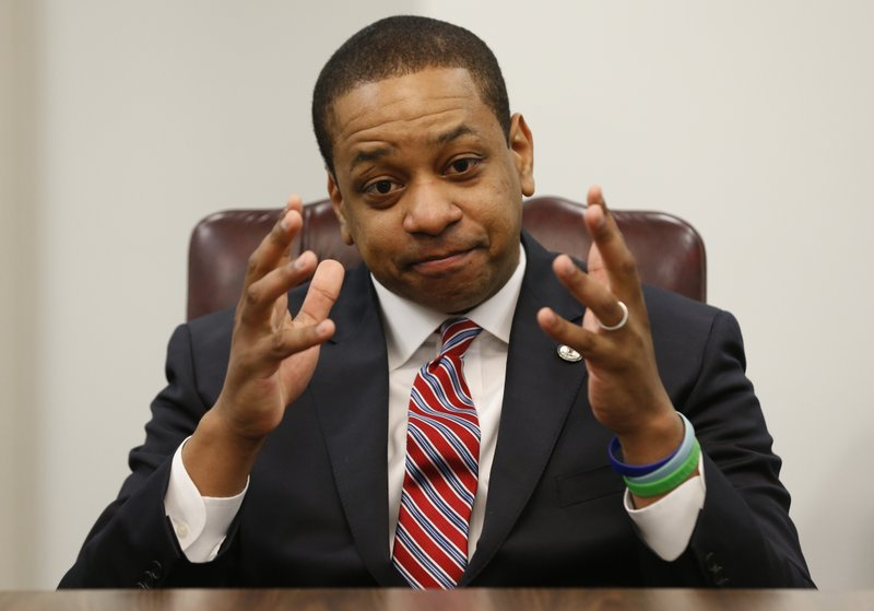 Virginia Lt. Gov. Justin Fairfax speaks during an interview in his office at the Capitol in Richmond, Va. (AP Photo/Steve Helber)