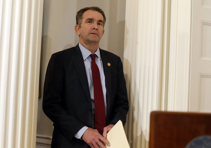 Virginia Gov. Ralph Northam arrives for a news conference in the Governor's Mansion in Richmond, Va., on Saturday, Feb. (AP Photo/Steve Helber)