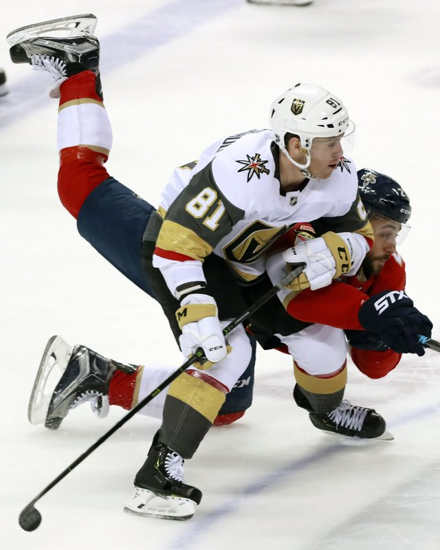 Vegas Golden Knights center Jonathan Marchessault (81) and Florida Panthers center Vincent Trocheck battle for the puck during the second period of an NHL hockey game, Saturday, Feb. (AP Photo/Wilfredo Lee)