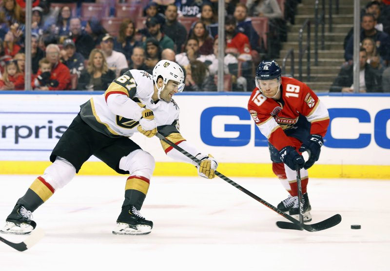 Vegas Golden Knights left wing Max Pacioretty (67) shoots and scores against Florida Panthers defenseman Mike Matheson (19) during the first period of an NHL hockey game, Saturday, Feb. (AP Photo/Wilfredo Lee)
