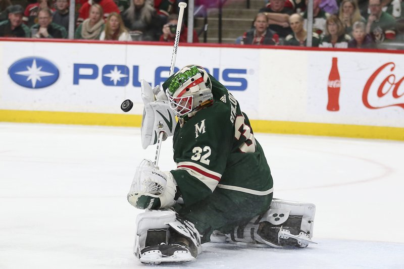 Minnesota Wild's goalie Alex Stalock blocks the puck during the second period of the team's NHL hockey game against the Chicago Blackhawks, Saturday, Feb. (AP Photo/Stacy Bengs)
