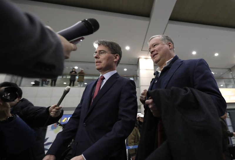 U.S. Special Representative for North Korea Stephen Biegun, right, is questioned by reporters upon his arrival at Incheon International Airport in Incheon, South Korea, Sunday, Feb. (AP Photo/Lee Jin-man)
