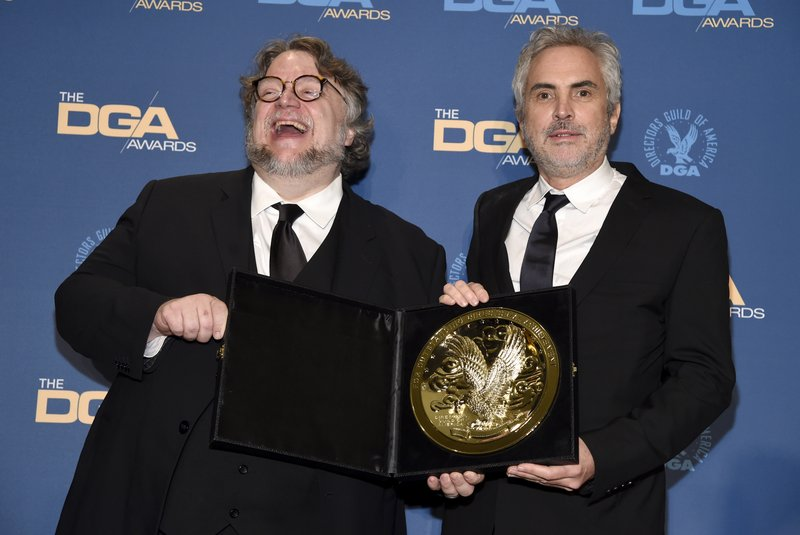 Guillermo del Toro, left, poses in the press room with Alfonso Cuaron, winner of the award for outstanding directorial achievement in feature film for