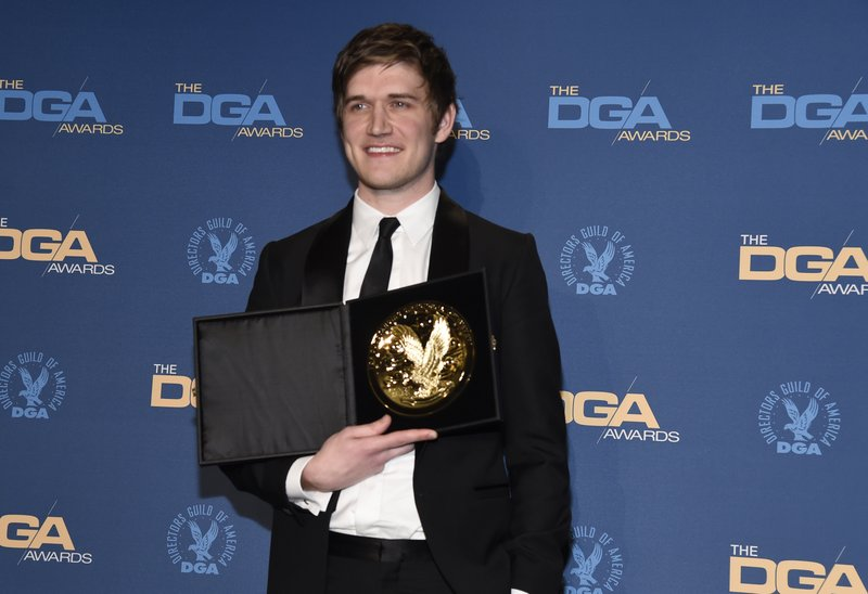 Bo Burnham poses in the press room with the award for outstanding directorial achievement of a first-time feature film for