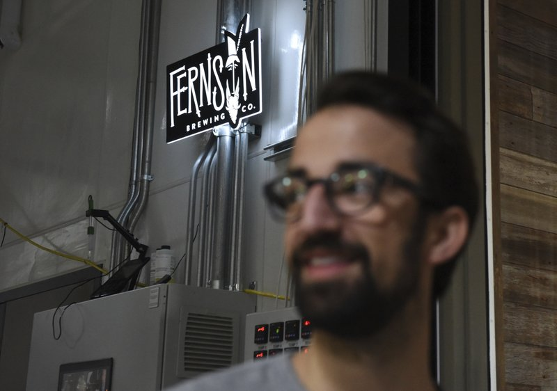 The Fernson Brewing Company sign is shown behind CEO Joel Thompson, Monday, Jan. 7, 2019 in Sioux Falls, S. (Loren Townsley/The Argus Leader via AP)