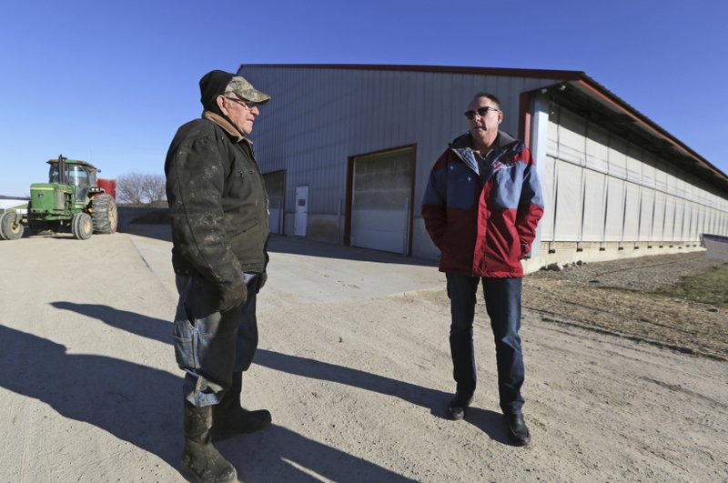 Randy Roecker, right, talks with his father, Gerald, on his farm in Loganville, Wis., Wednesday, Jan. (Amber Arnold/Wisconsin State Journal via AP)