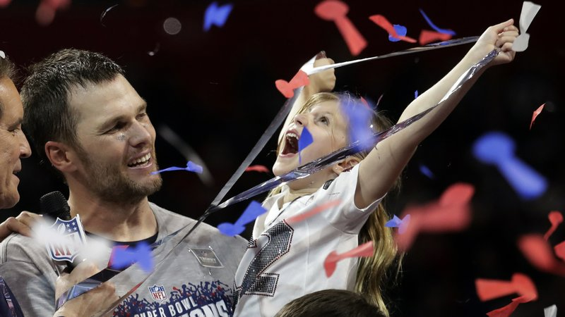 New England Patriots' Tom Brady holds his daughter, Vivian, after the NFL Super Bowl 53 football game against the Los Angeles Rams, Sunday, Feb. (AP Photo/Lynne Sladky)