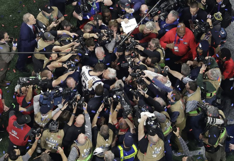New England Patriots' Tom Brady (12) embraces Patriots owner Robert Kraft after the NFL Super Bowl 53 football game against the Los Angeles Rams, Sunday, Feb. (AP Photo/Morry Gash)