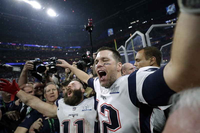 New England Patriots' Julian Edelman, left, and Tom Brady celebrate after the NFL Super Bowl 53 football game against the Los Angeles Rams, Sunday, Feb. (AP Photo/David J. Phillip)